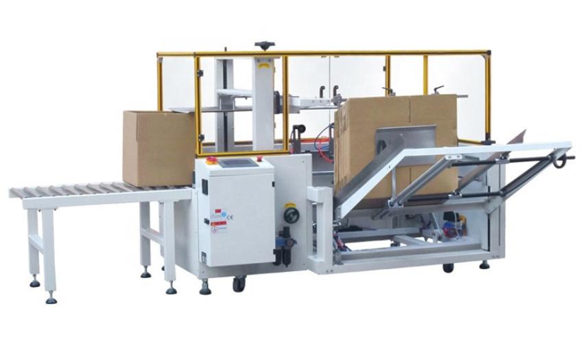 Naprava za avtomatsko sestavljanje kartonskih škatel in lepljenje spodnjega dela s salotejpom